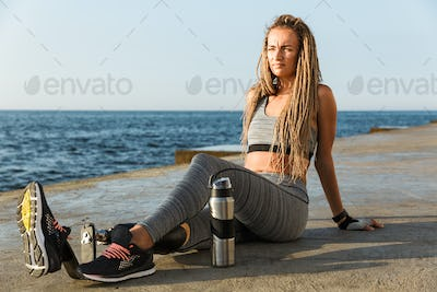 Attractive disabled athlete woman with prosthetic leg