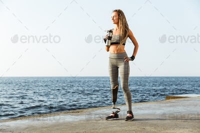 Full length of confident disabled athlete woman