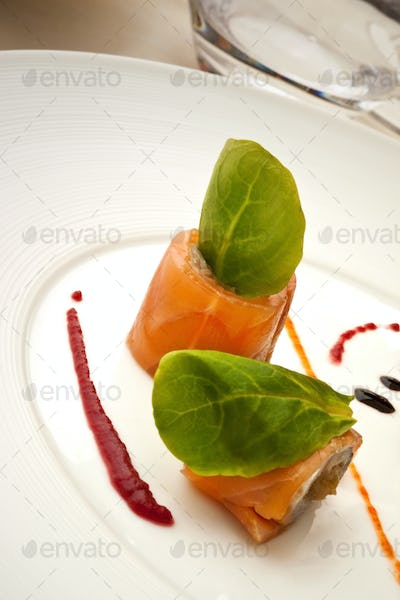 Salmon fillet and salad