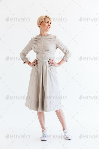 Full length portrait of charming blond adult woman 40s wearing d