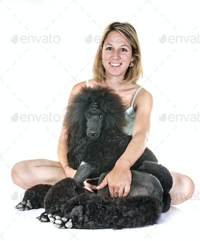 black standard poodle and woman