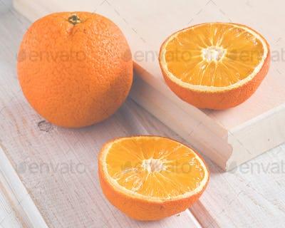 oranges on white wood