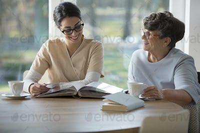 Senior woman with tender caregiver