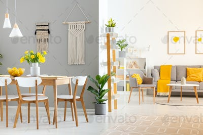 Real photo of a spacious home interior with wooden table, white