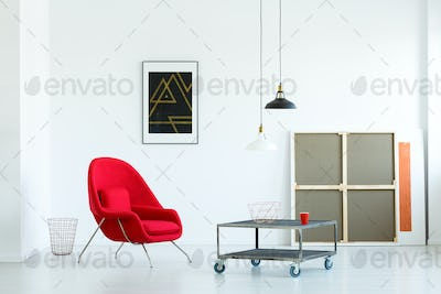 Minimalistic living room interior with a movable coffee table, r