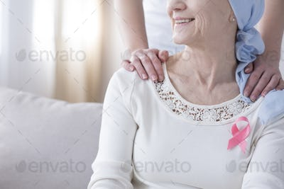 Senior woman with pink ribbon