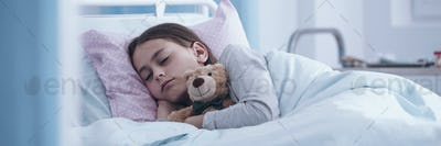 Panorama portrait of a sick little girl sleeping in a hospital b
