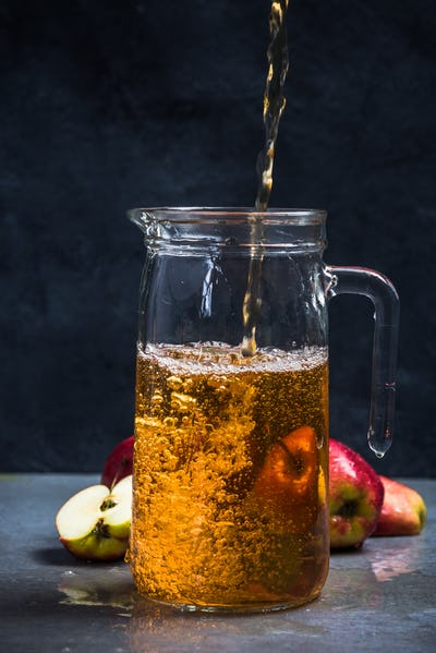 Pouring fresh filtered apple juice