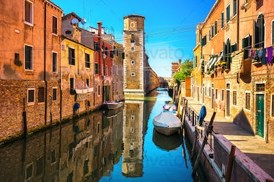 Venice cityscape, buildings, water canal and tower. Italy