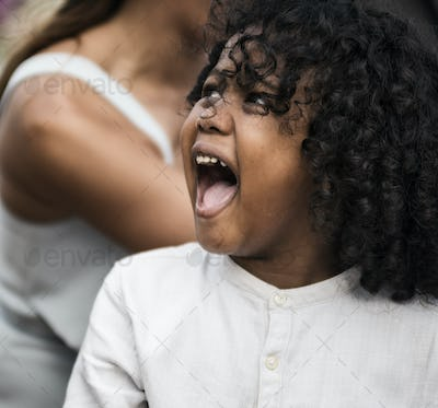 Closeup of little boy at a wedding ceremony