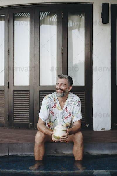 Man drinking a fresh coconut