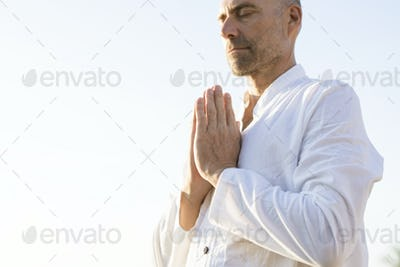 Man practicing yoga in the morning