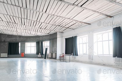 Photo studio with large windows and circle walls