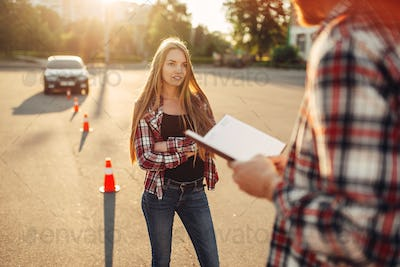 Male instructor and female student, driving school