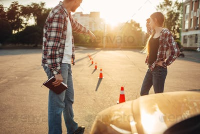 Instructor and woman, lesson for novice drivers