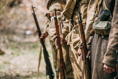 Close Up Of Re-enactors Dressed As Soviet Infantry Soldiers Of W
