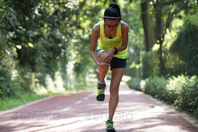 Woman runner with sports injured knee