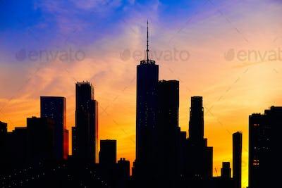New York City skyline silhouette, at sunset.