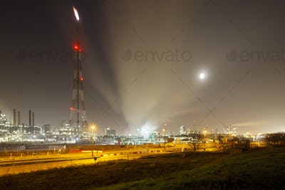 Refinery With Flare At Night