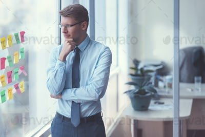 Young businessman by the window