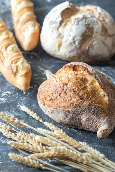Different kinds of bread on the wooden background