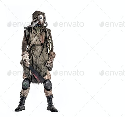 Post apocalyptic survivor in gas mask and rags