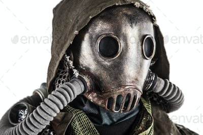 Portrait of post apocalyptic survivor in gas mask