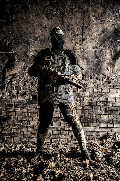 Post apocalypse soldier aiming with handmade gun