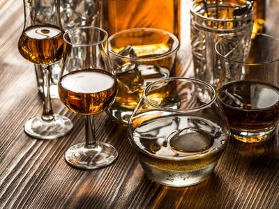 Varous glasses of whiskey on a table