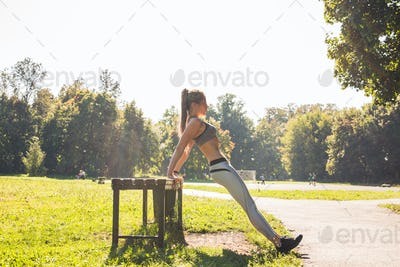 sport, fitness, exercise and lifestyle concept - woman doing sports outdoors.