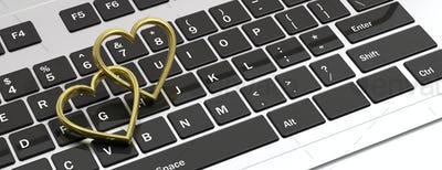 Pair of golden wedding rings isolated on computer laptop keyboard, banner, 3d illustration