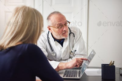 Woman having consultation with doctor at laptop