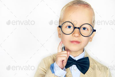 Studio shot of little boy in suit