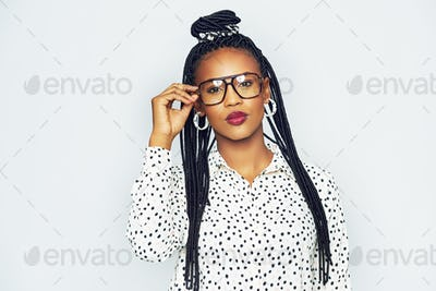 Fashionable black woman wearing glasses