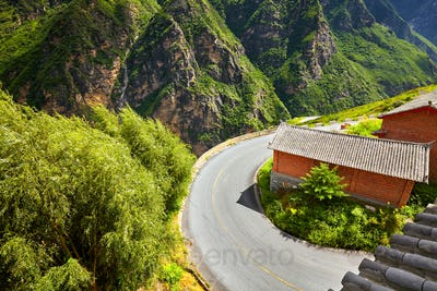 Scenic mountain road sharp turn.