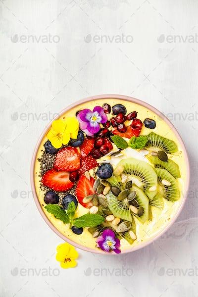 Mango banana pineapple turmeric smoothie bowl
