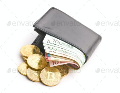 The golden bitcoin and euro money in wallet.