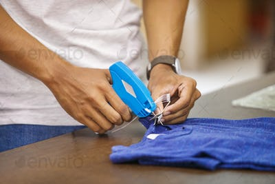 worker at clothing company labelling their product
