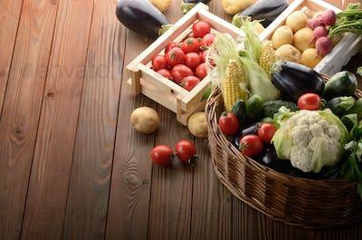 Basket of Organic Vegetable Food Ingredients and crates of potat