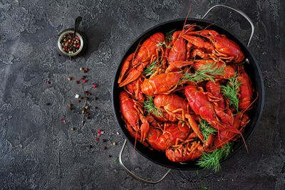 Crayfish. Red boiled crawfishes on table in rustic style, closeup