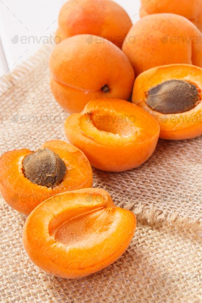 Fresh ripe apricot containing vitamins, healthy sweet eating concept