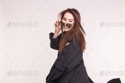 asian woman looking at you over the glasses over white background