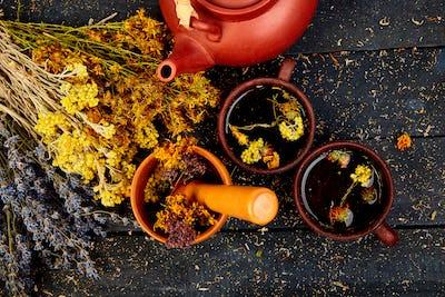 Healing herbs on wooden black table, herbal medicine