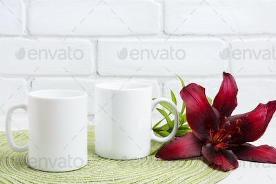 Two coffee mug mockup with maroon lily