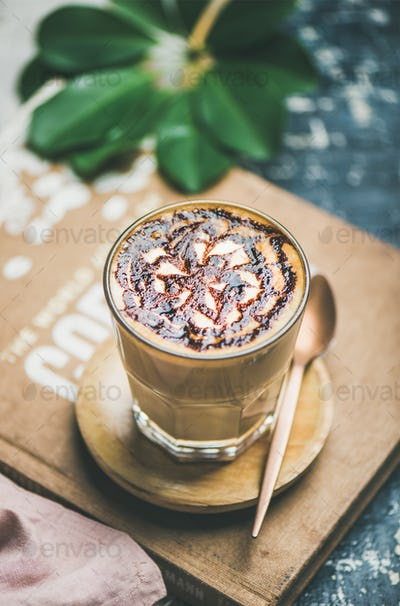 Classic Latte coffee with chocolate sauce pattern in glass