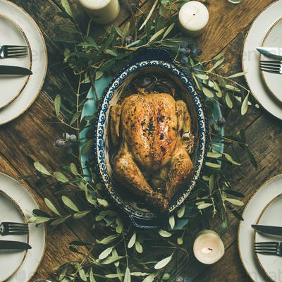 Flat-lay of whole roasted chicken for Christmas, square crop