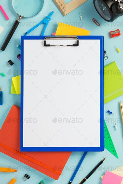 paper clipboard and school accessories