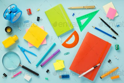 notebook and school accessories at abstract background