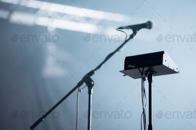 Microphone and audio mixer in stage lights