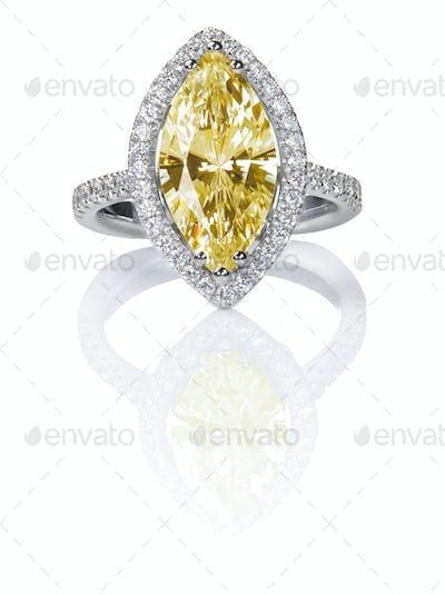 Fancy Yellow Beautiful Diamond Engagement ring. Gemstone Marquise cut surrounded by halo diamonds.